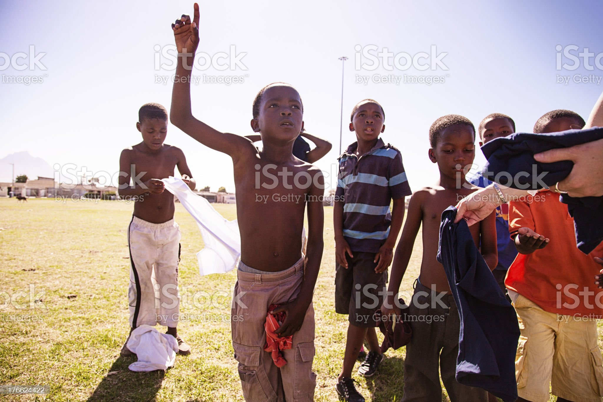 African Kids getting ready for football game, Gugulethu royalty-free stock photo