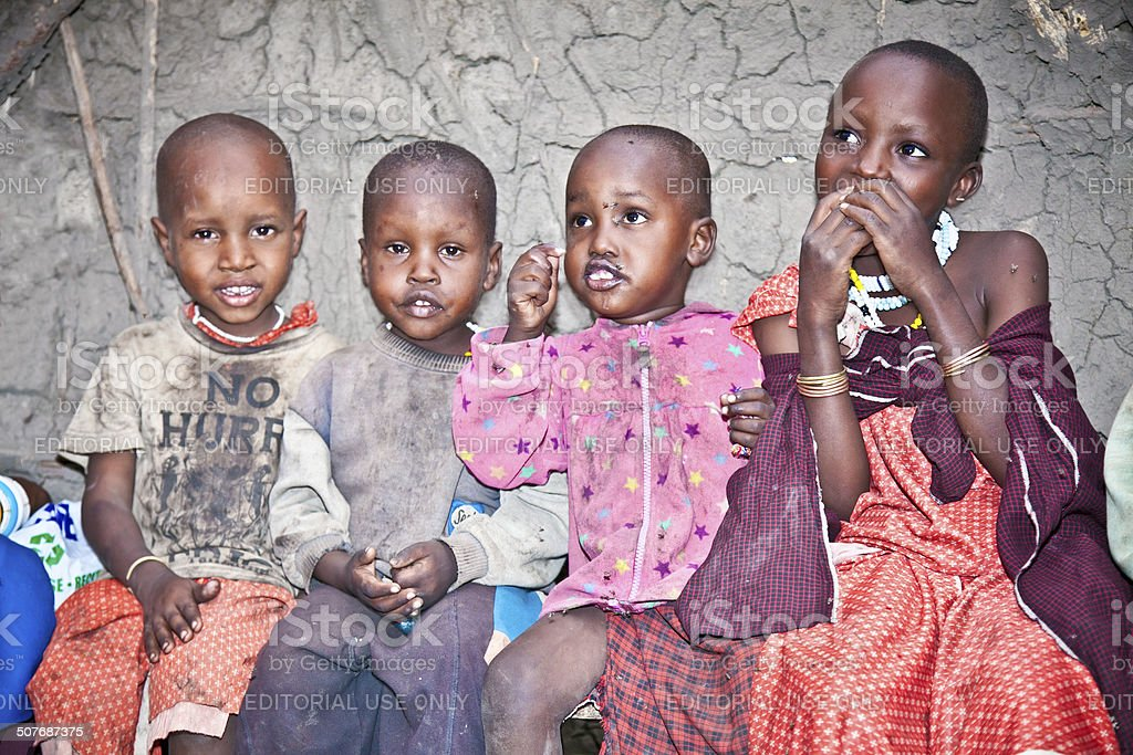 African Kids of Masai  tribe village stock photo