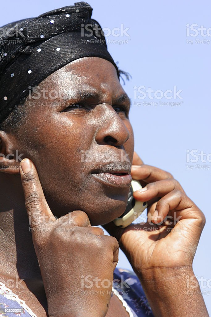 African Lady on a Cellphone Close Up royalty-free stock photo