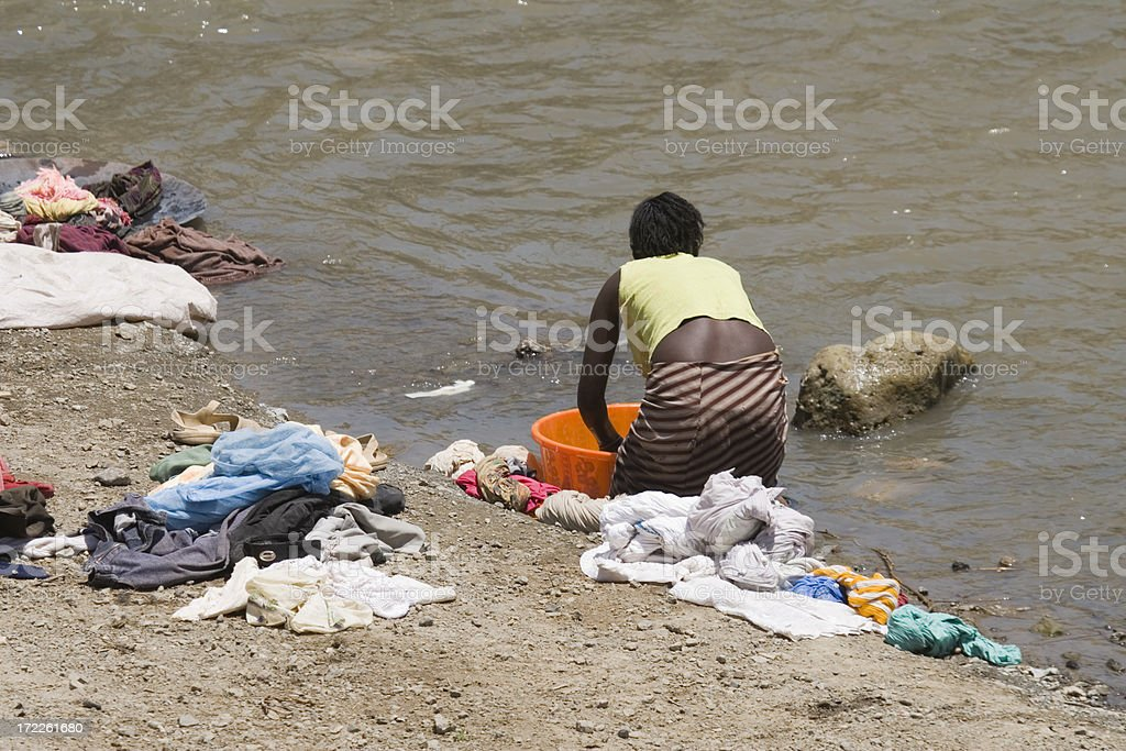 African life and laundry at the river royalty-free stock photo