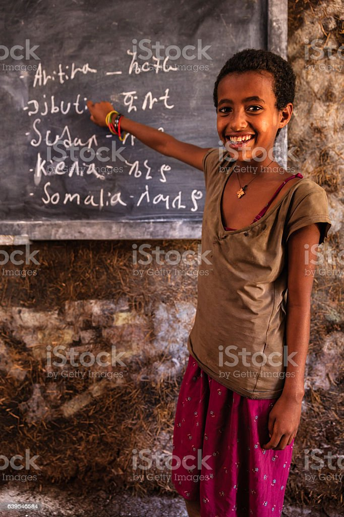 African little girl is learning Amharic language stock photo