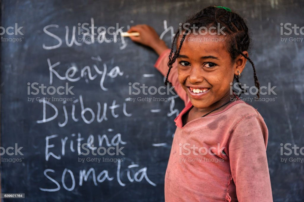 African little girl is learning  English language stock photo