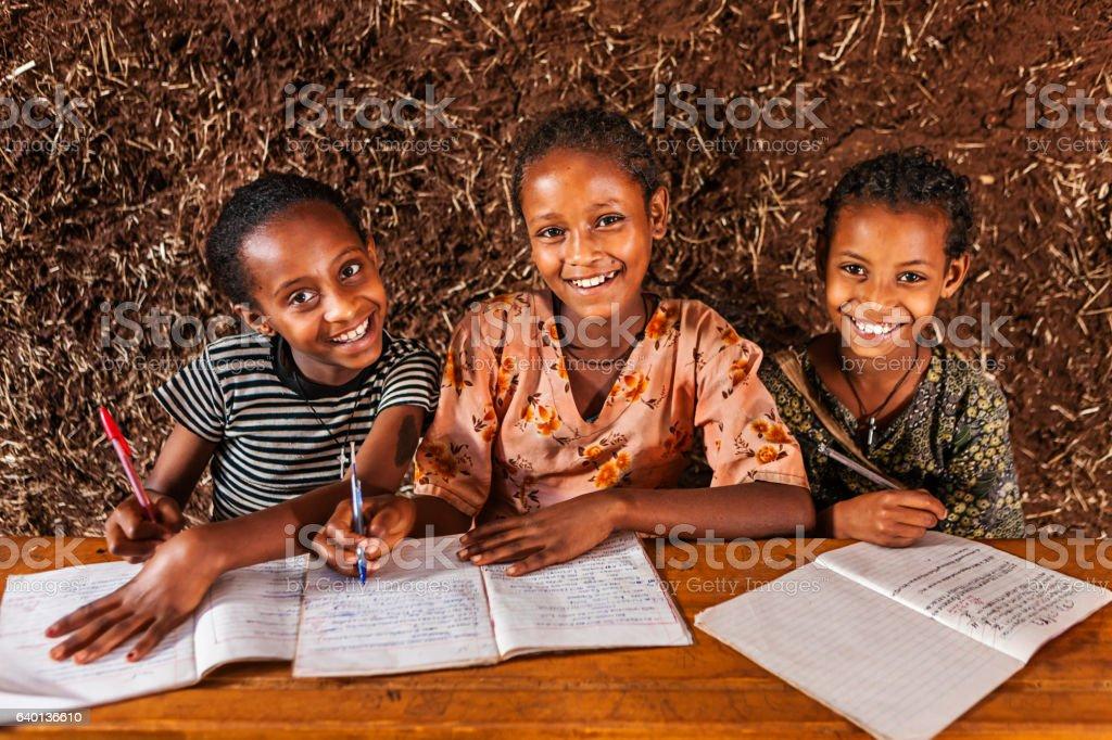 African little girla learning Amharic language stock photo