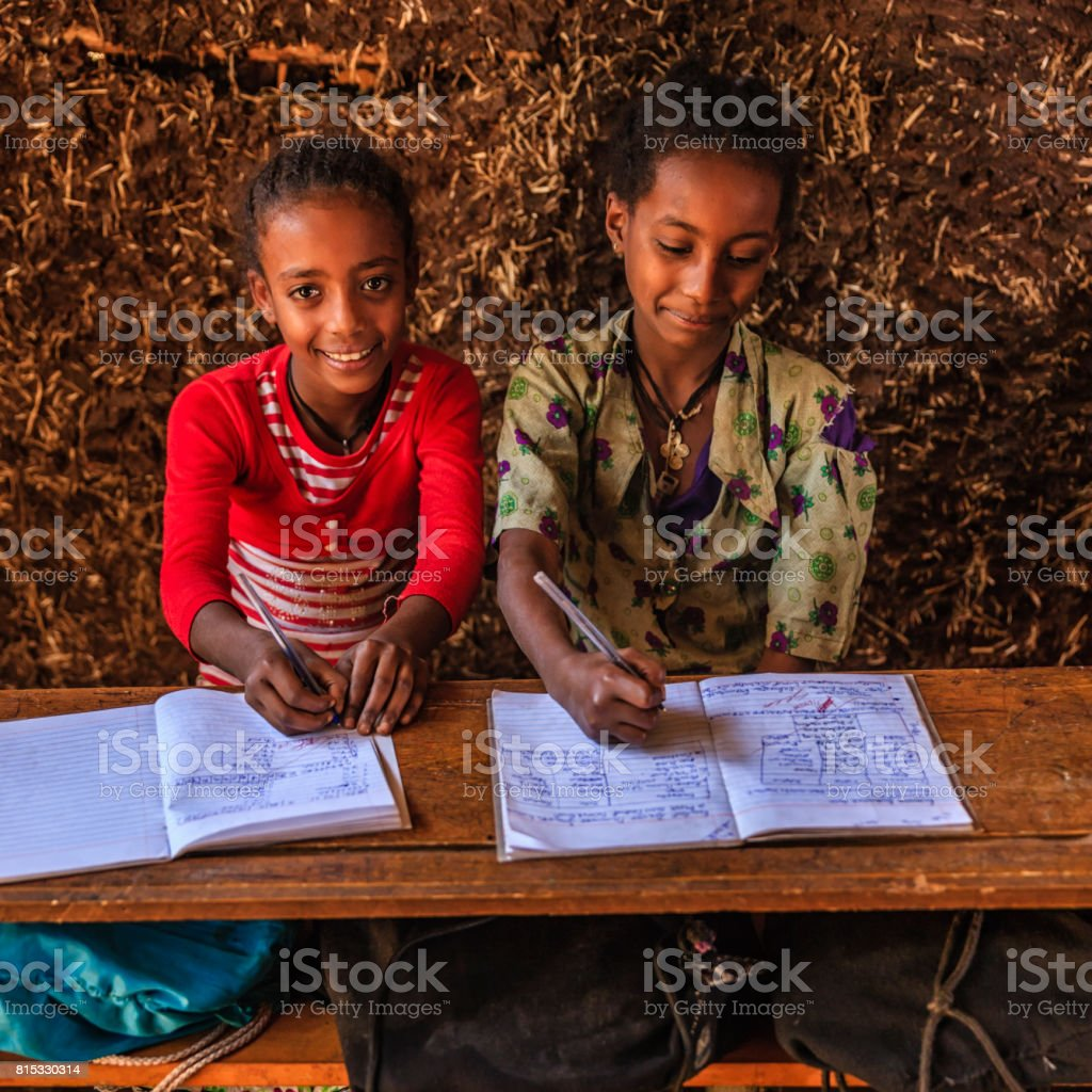 African little girls during the class, East Africa stock photo