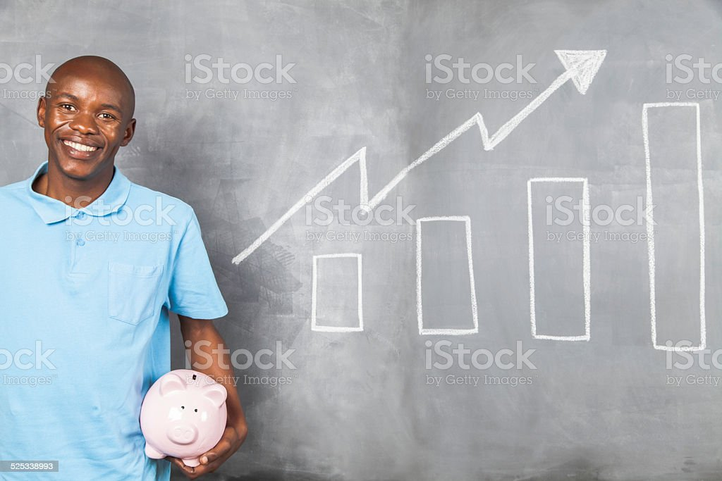 African male happy with the growth of his savings stock photo