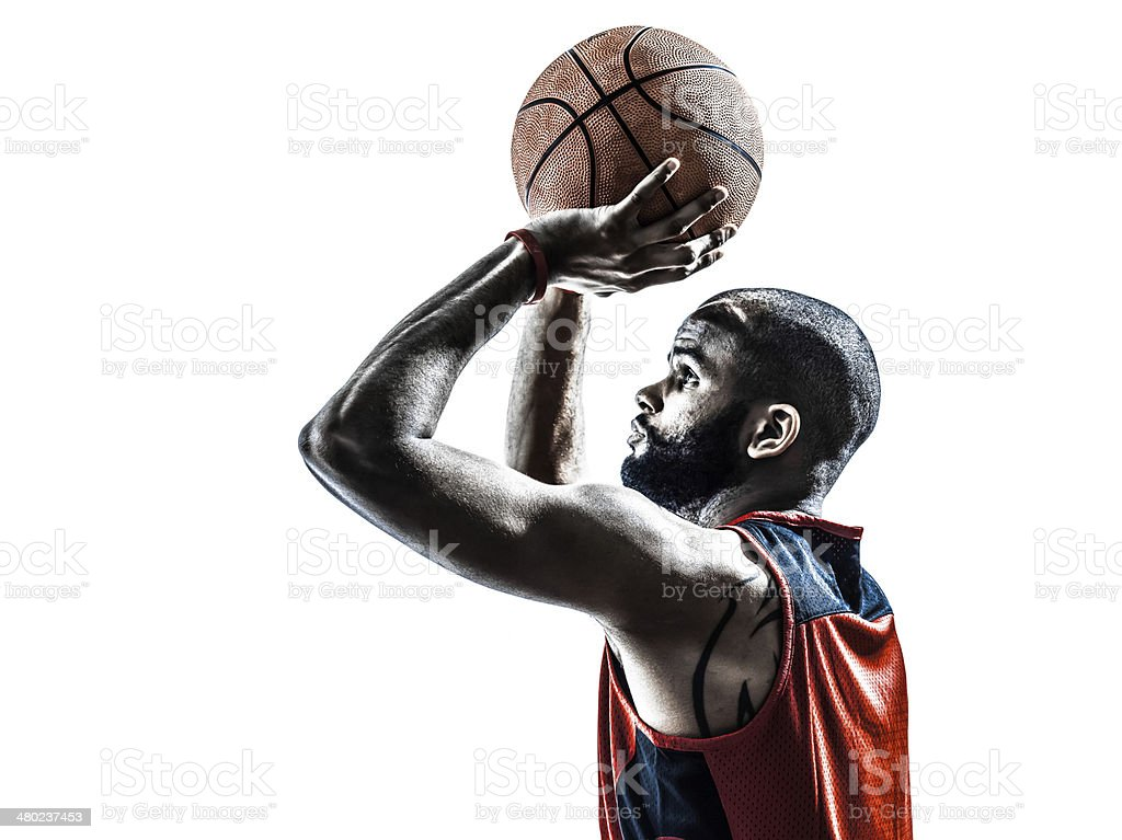 african man basketball player free throw silhouette stock photo