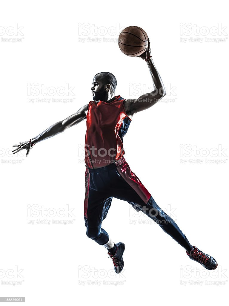 african man basketball player jumping dunking silhouette stock photo