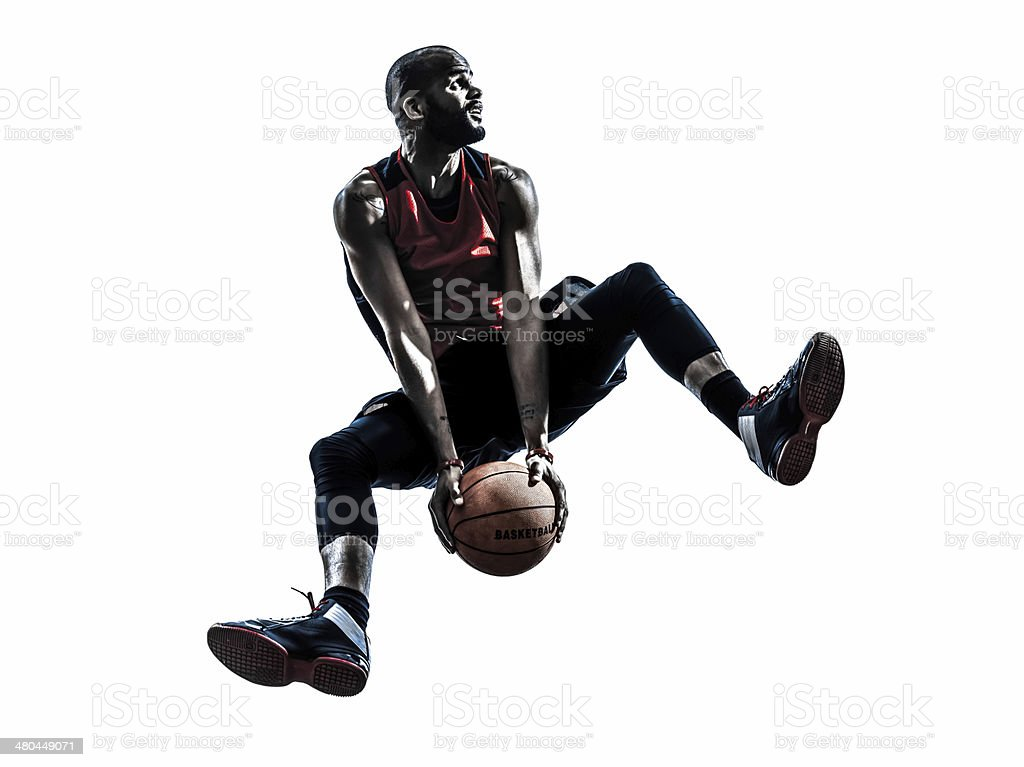 african man basketball player jumping silhouette stock photo