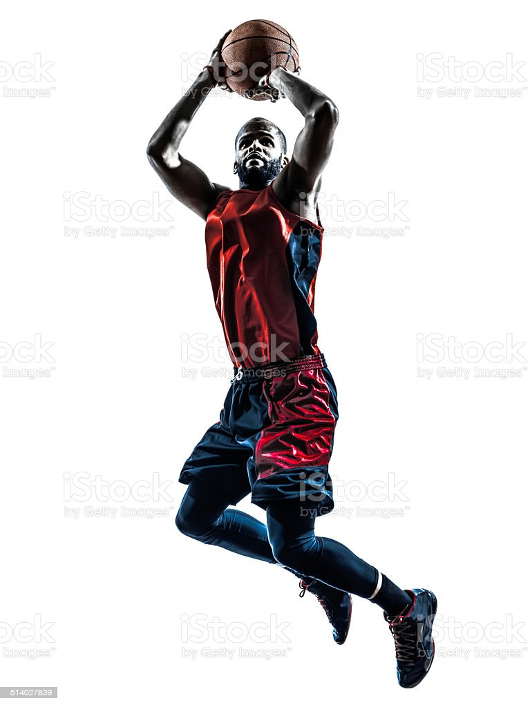 african man basketball player jumping throwing silhouette stock photo