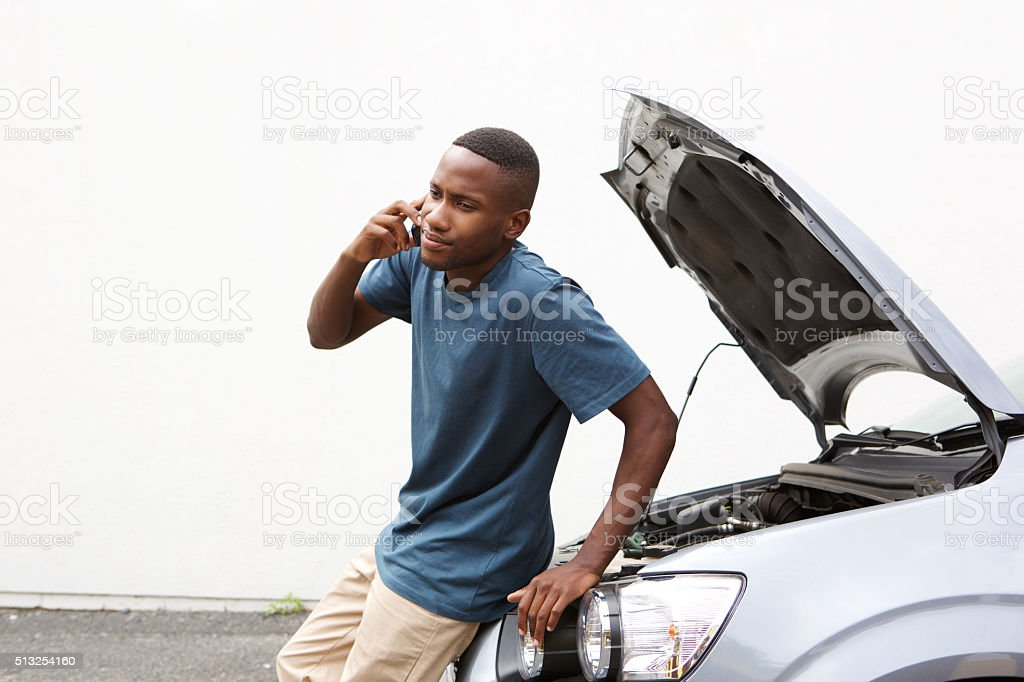 African man calling on cellphone for car service stock photo