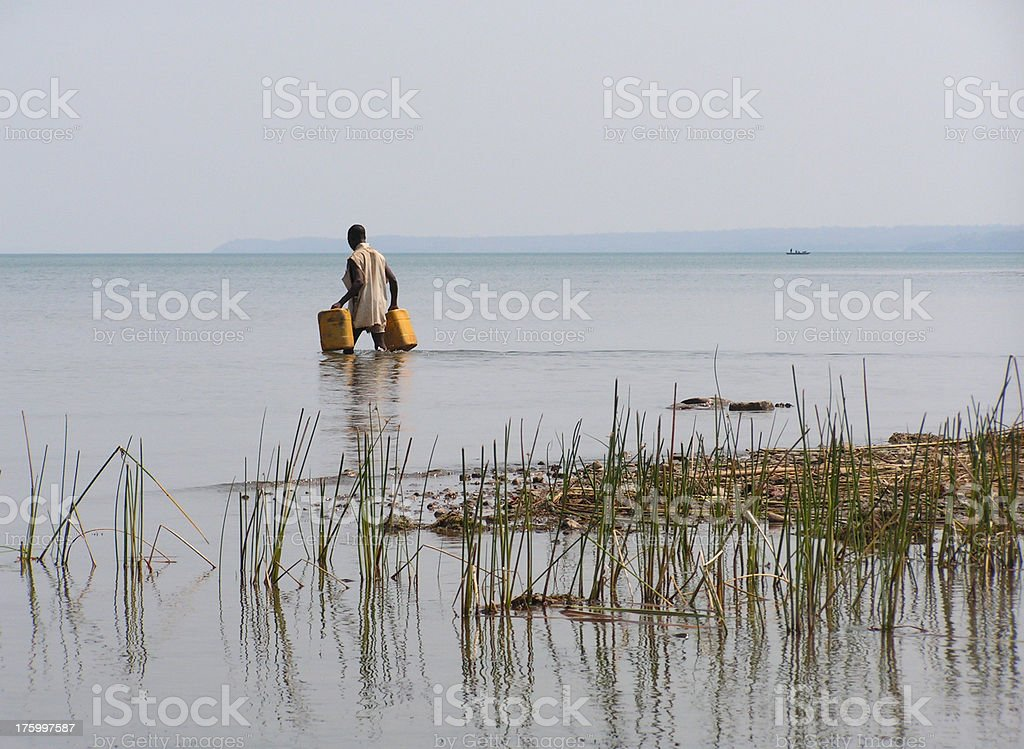 African man collecting water stock photo