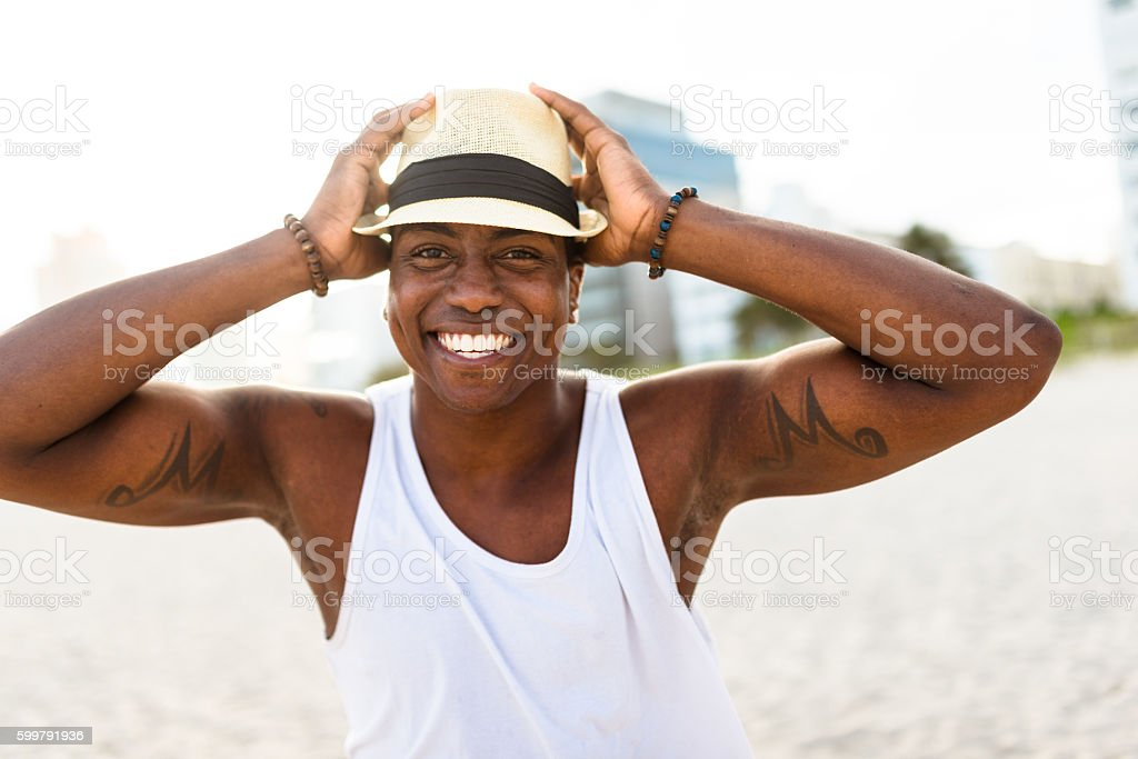 African man dancing on Miami beach stock photo