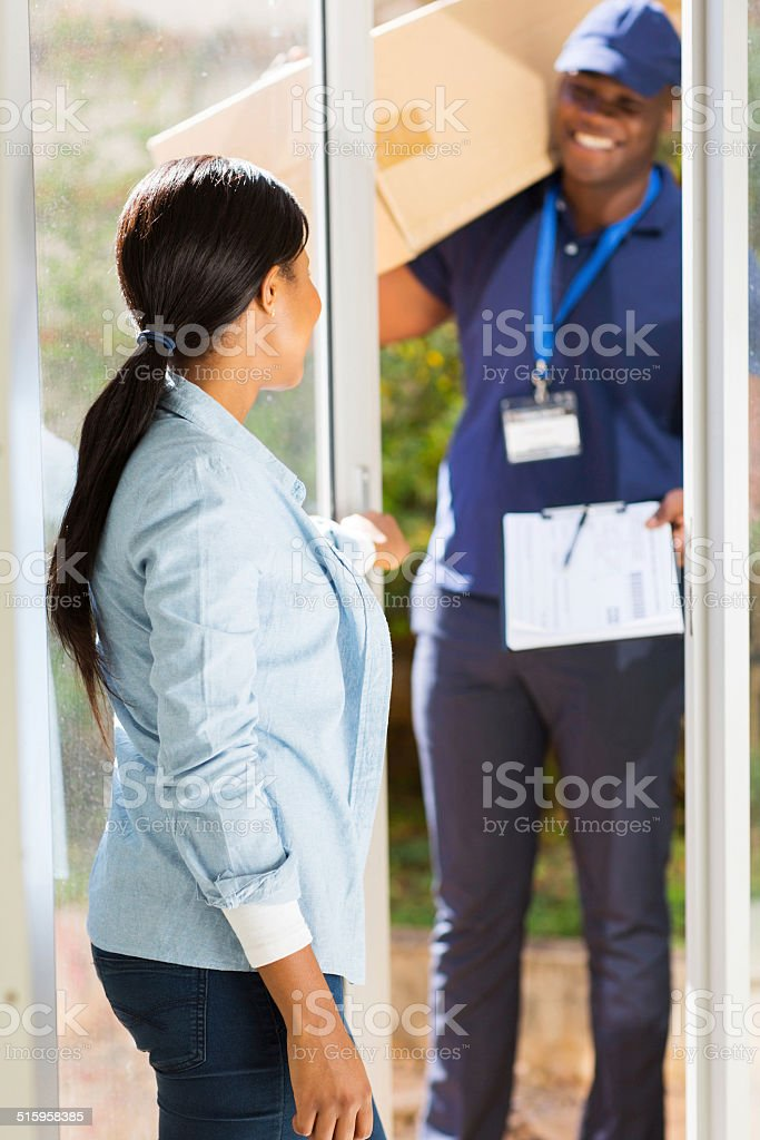 african man delivering a parcel stock photo
