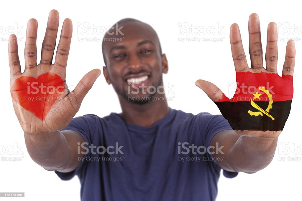 African man hands with a painted heart and angolan flag royalty-free stock photo