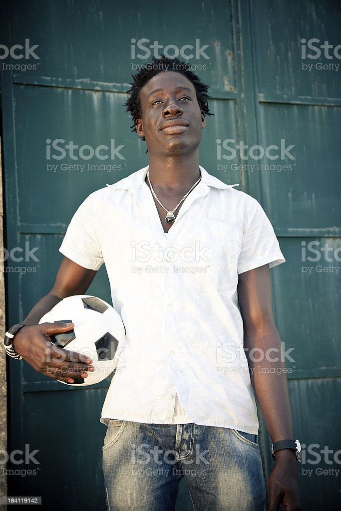 African Man Holding A Soccer Ball royalty-free stock photo