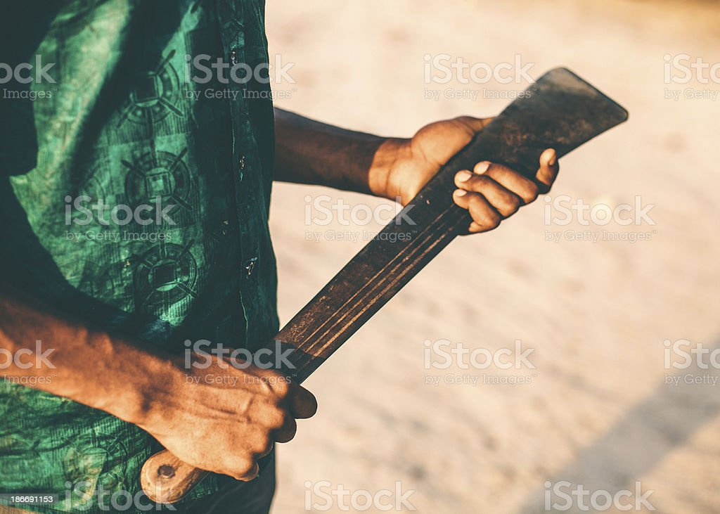 African man holding machete. stock photo