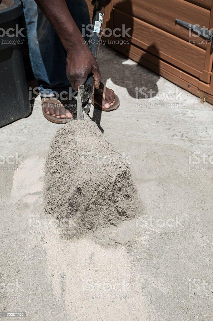African man mixes cement stock photo