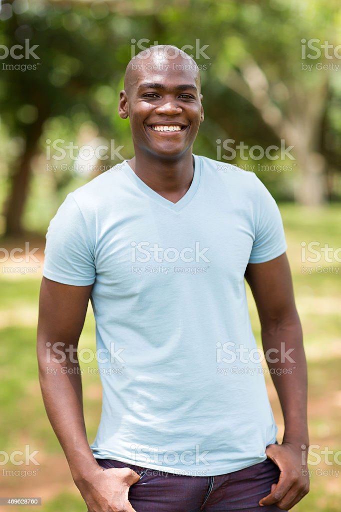 african man outdoors stock photo