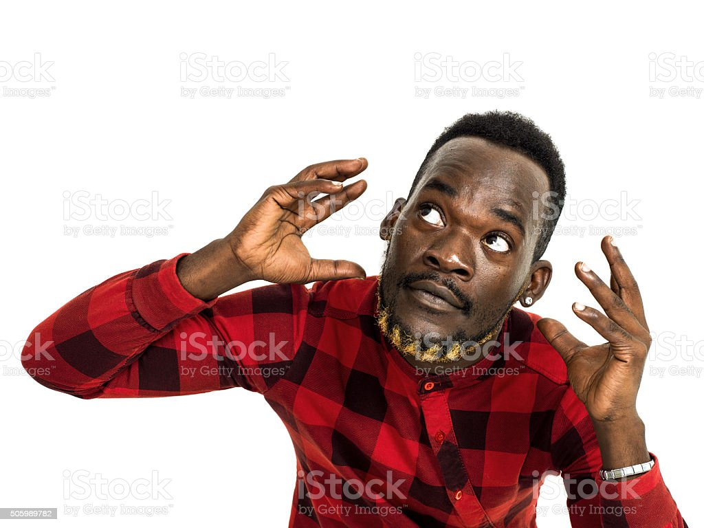 African man portrait wearing red chequed shirt and gesturing stock photo