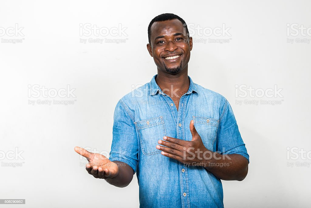 African man presenting stock photo