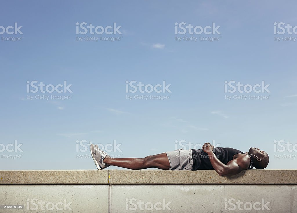 African man relaxing after his workout stock photo