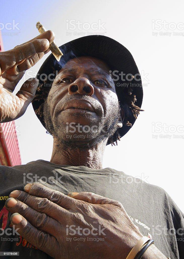 African Man Smoking royalty-free stock photo