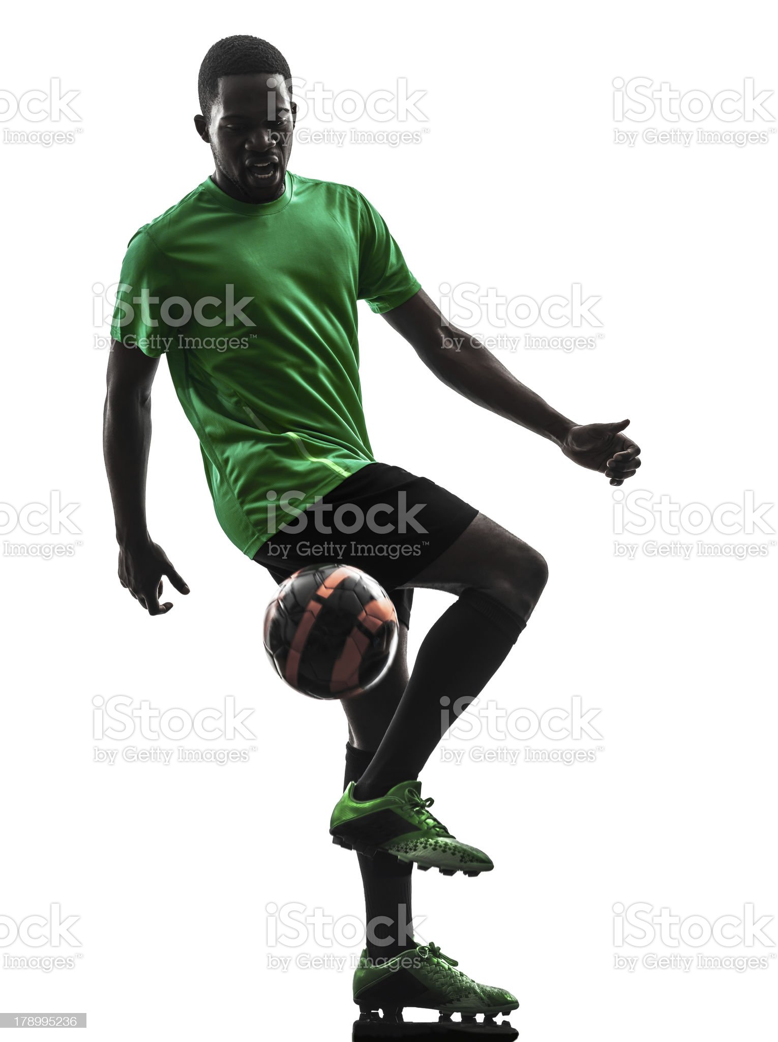 african man soccer player  juggling silhouette royalty-free stock photo