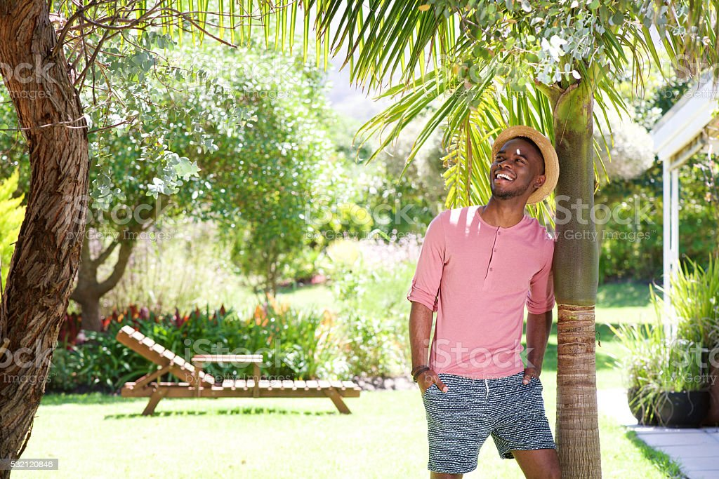 African man standing outdoors on a summer day stock photo