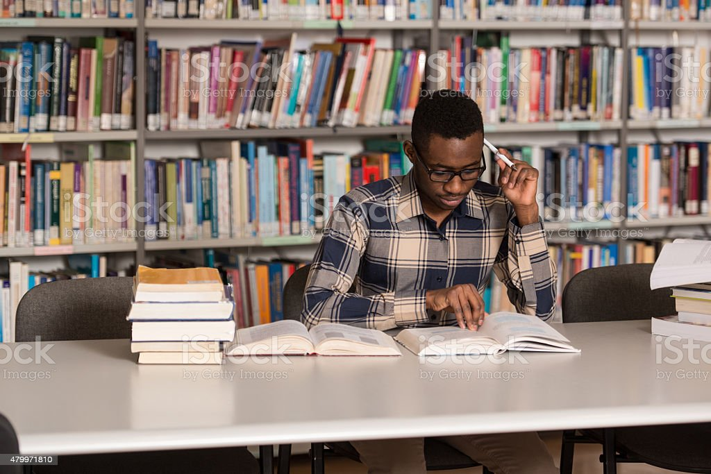African Man Studying In A Library stock photo