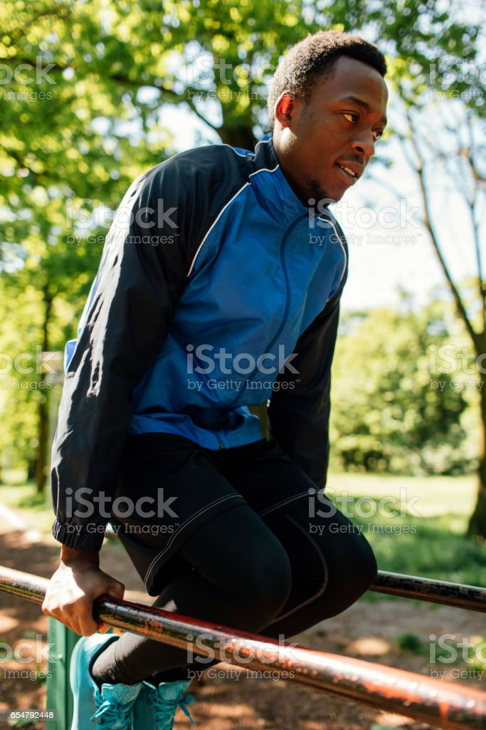 African man training in park stock photo