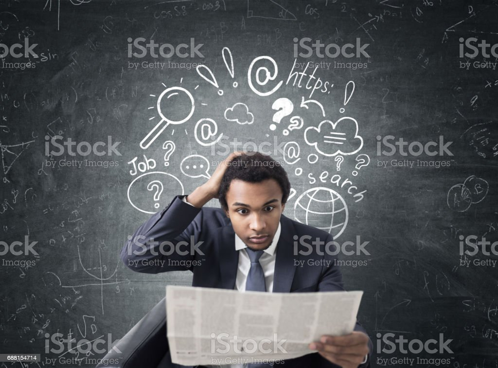 African man with newspaper, internet search stock photo