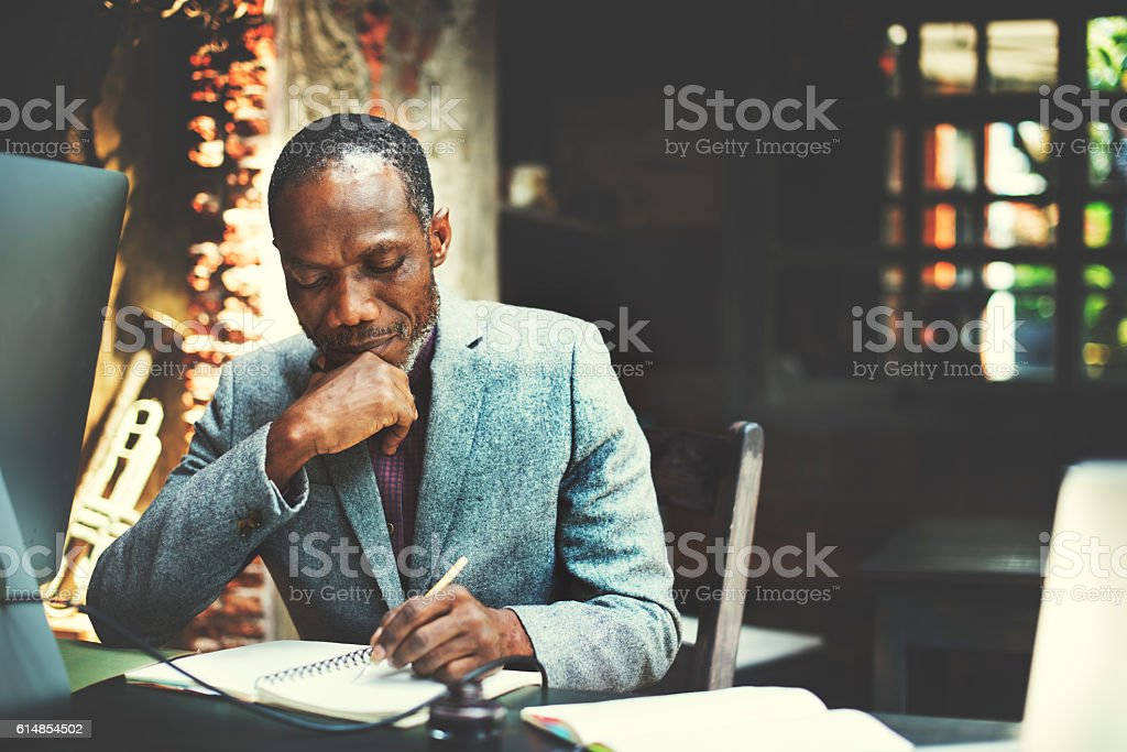 African Man Working Determine Workspace Lifestyle Concept stock photo