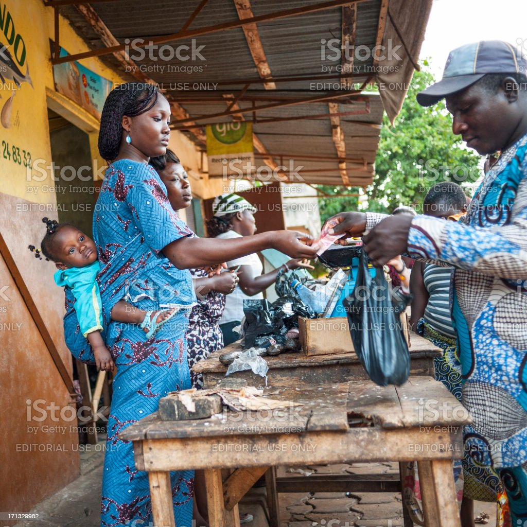 \'Ouidah, Benin - September 2, 2012: Local man just bought a plastic...
