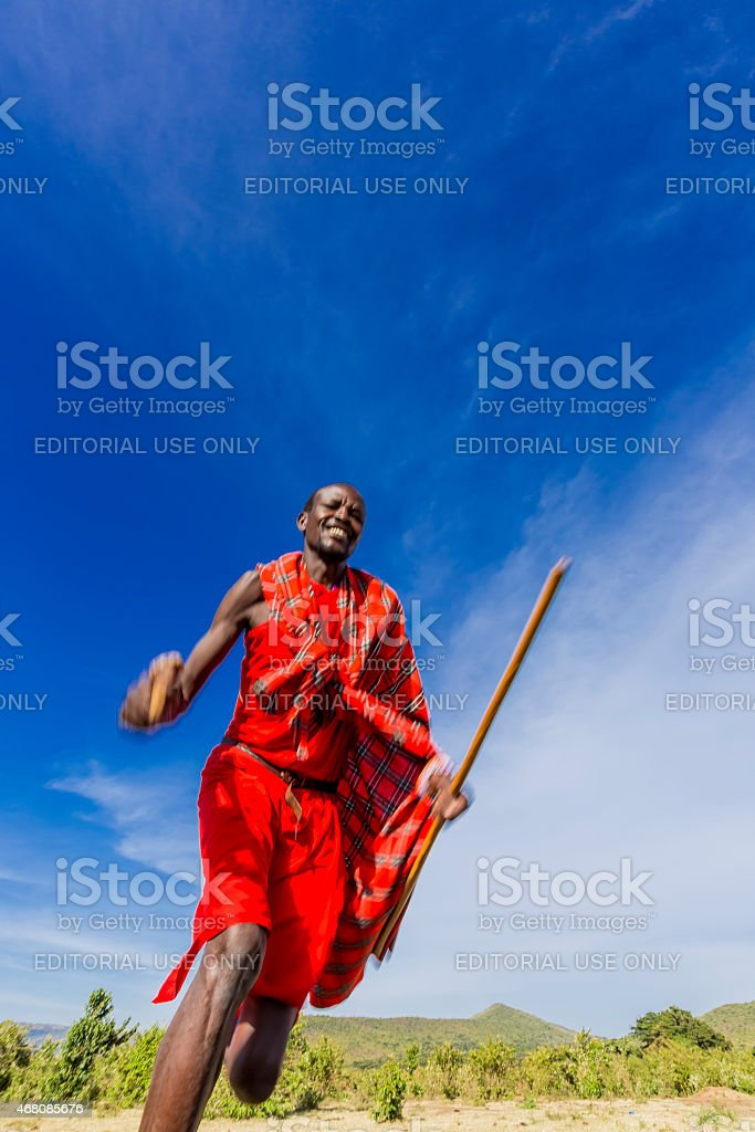 African masai man is running at savannah stock photo