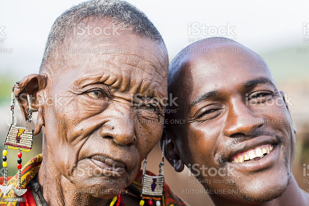 African masai old cataract woman and her sun are posing stock photo