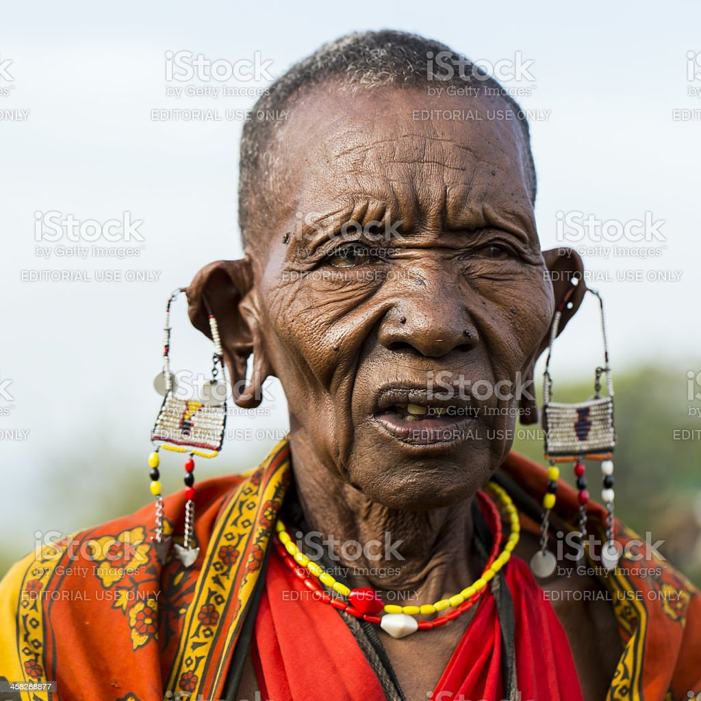 African masai old woman is posing - cataract / open-mouth stock photo