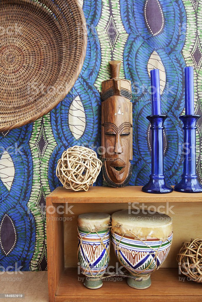 African mask and drums with ethnic pattern background stock photo