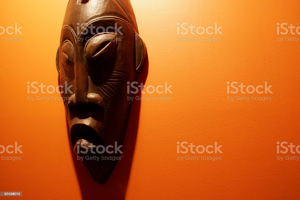 AFrican Mask on orange wall royalty-free stock photo
