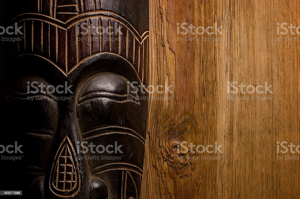 African mask over wooden background royalty-free stock photo