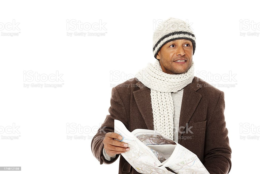 African mature man holding a map and looking away royalty-free stock photo