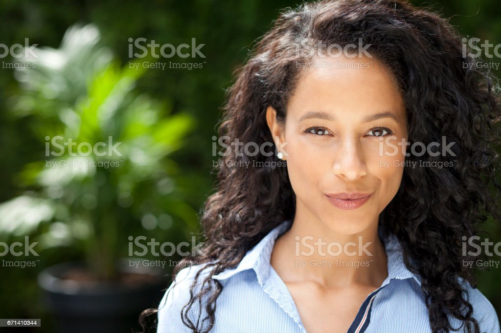 African Mature Woman Smiling At The Camera stock photo