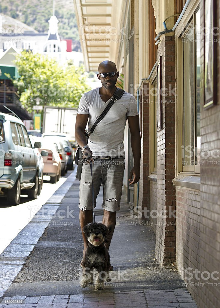 African metrosexual man with his dog royalty-free stock photo