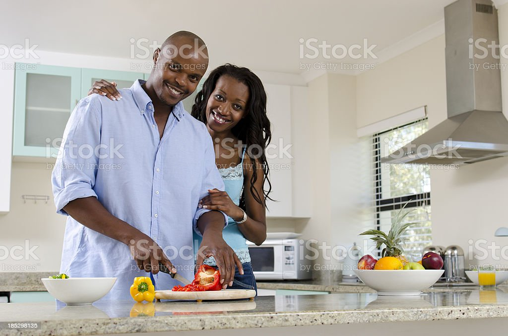 African middle class couple in the kitchen royalty-free stock photo