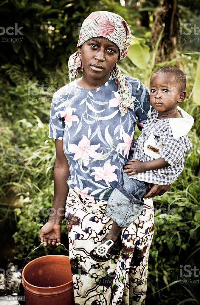 African Mother & Child Gathering Water royalty-free stock photo