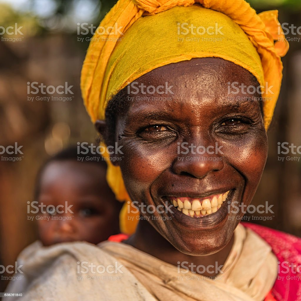 African mother holding her baby on back, East Africa stock photo