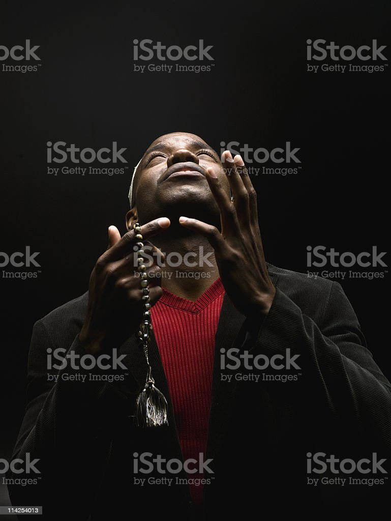African Muslim Man Praying stock photo