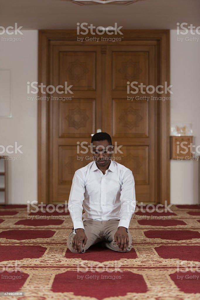 African Muslim Praying In Mosque stock photo