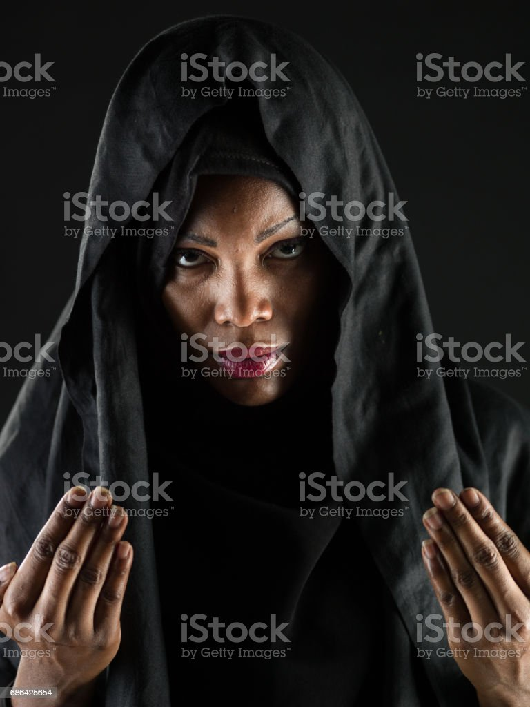 African muslim woman praying stock photo