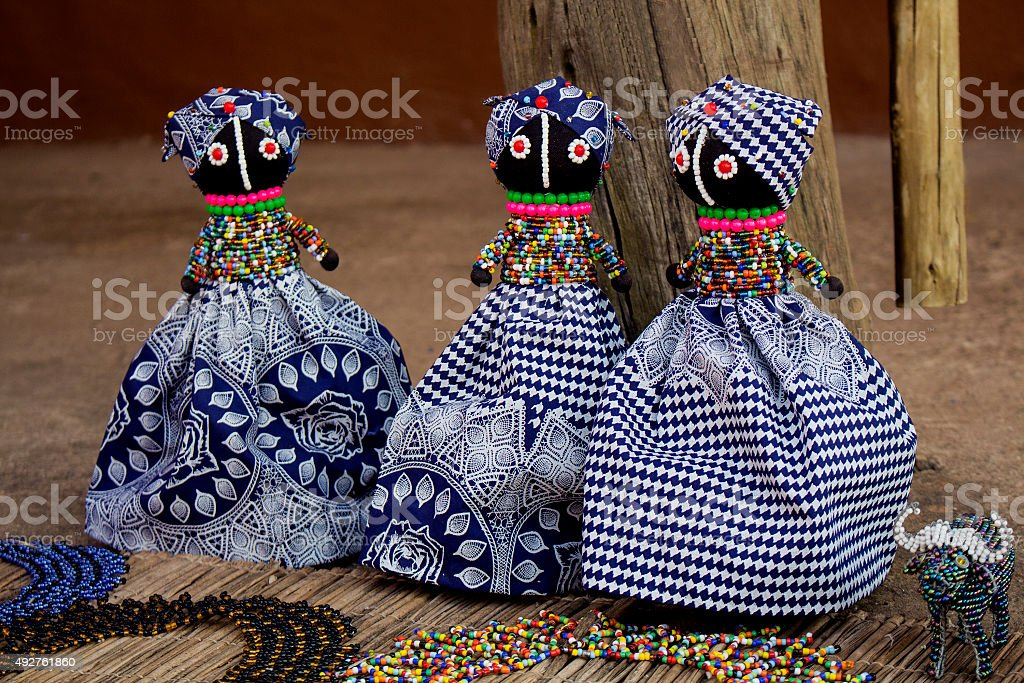 African rag dolls in traditional handmade colorful bead fabrics clothes. stock photo