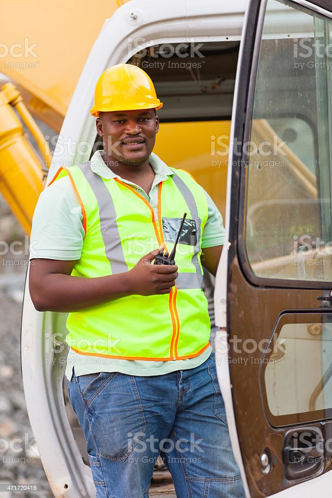 african road construction worker on bulldozer royalty-free stock photo